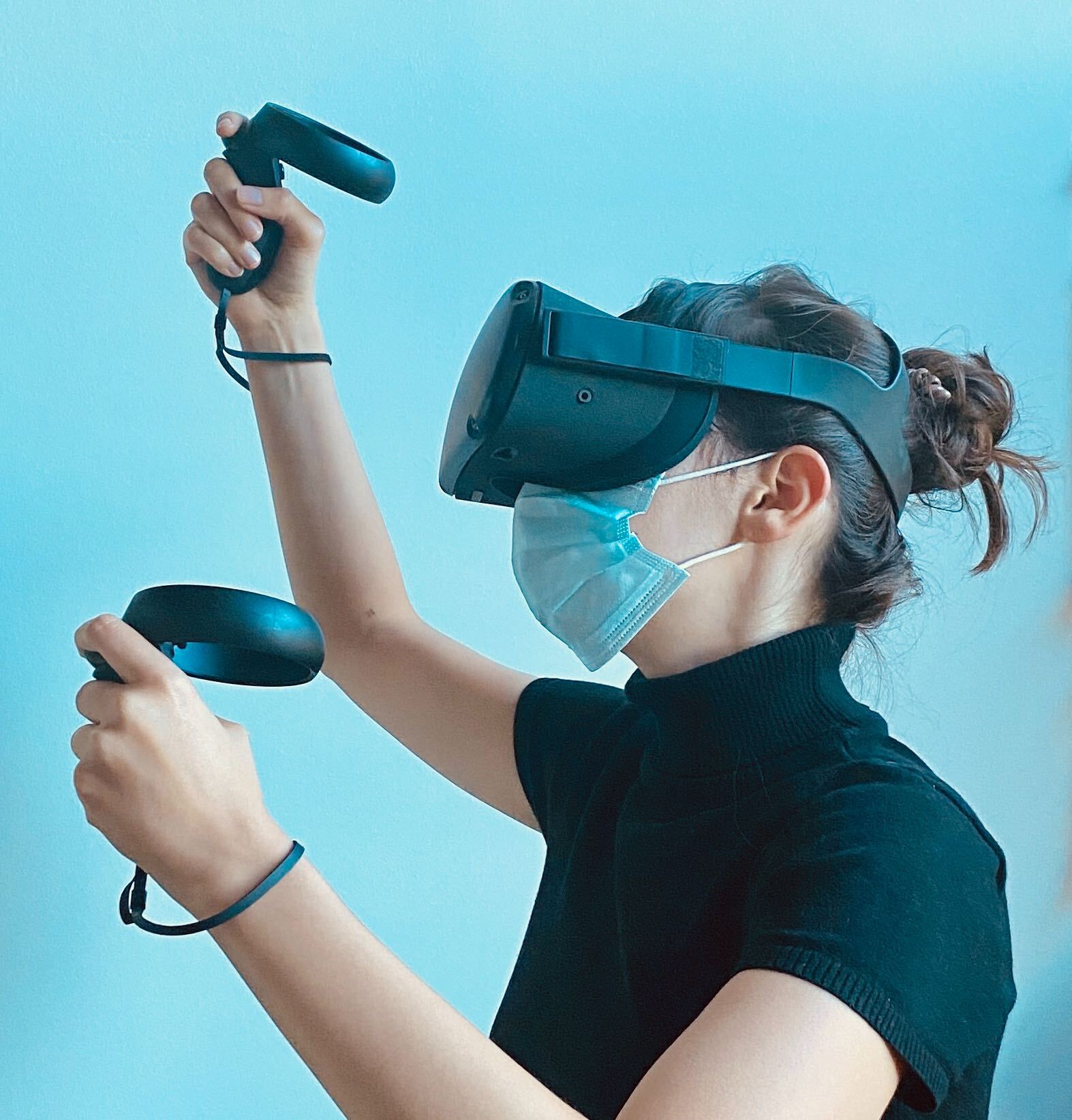 person in a VR headset wearing a mask