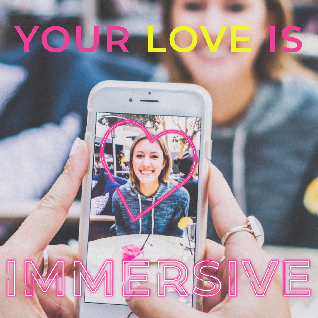 "person taking a photo of a woman with an augmented reality heart filter. Text reads, ""Your love is immersive."""