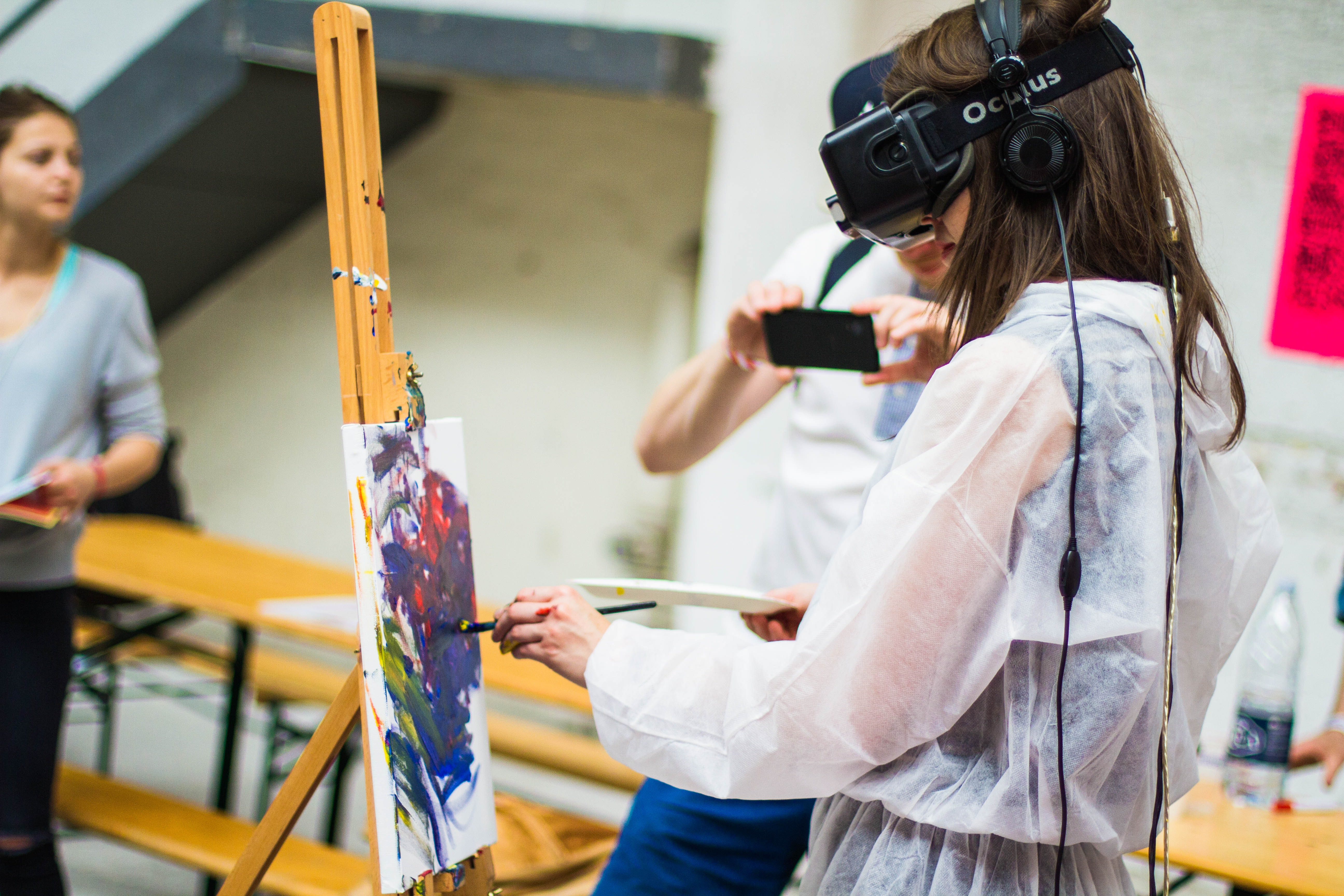 person wearing a vr headset and painting.