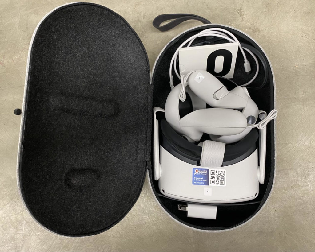 An open case with an Oculus Quest 2 virtual reality headset in it.