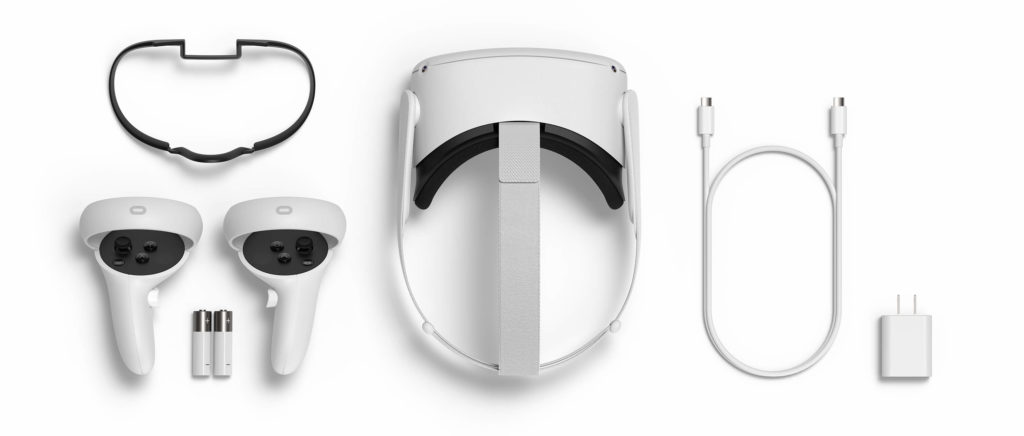 Oculus Quest 2 VR headset, controllers with batteries, charging cable and glasses spacer.